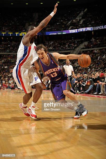 Steve Nash of the Phoenix Suns drives around Rodney Stuckey of the Detroit Pistons in a game at the Palace of Auburn Hills on February 8, 2009 in...