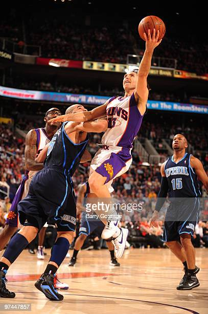 Steve Nash of the Phoenix Suns drives for a shot against Carlos Boozer of the Utah Jazz in an NBA Game played on March 4 2010 at US Airways Center in...