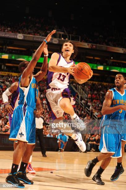 Steve Nash of the Phoenix Suns drives for a shot against the New Orleans Hornets in an NBA Game played on November 11 2009 at US Airways Center in...