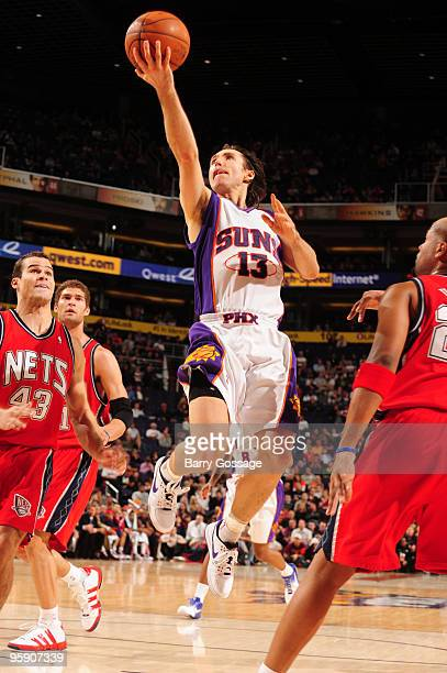 Steve Nash of the Phoenix Suns drives for a shot against the New Jersey Nets in an NBA game played on January 20 2010 at US Airways Center in Phoenix...