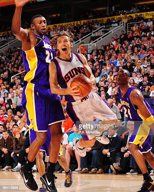 Steve Nash of the Phoenix Suns drives for a shot around Didier IlungaMbenga of the Los Angeles Lakers in an NBA Game played on December 28 2009 at US...