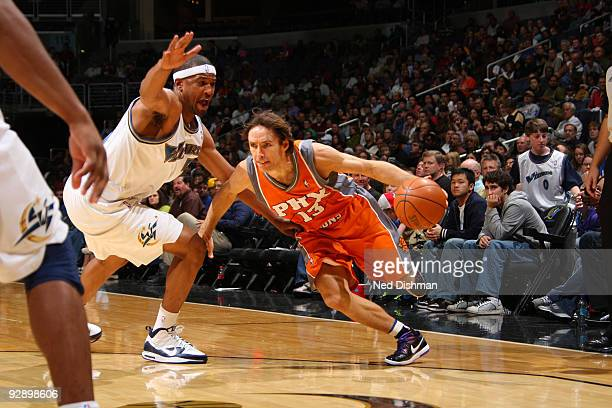 Steve Nash of the Phoenix Suns drives past Dominic McGuire of the Washington Wizards at the Verizon Center during game on November 8 2009 in...