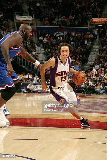 Steve Nash of the Phoenix Suns drives the ball against Shaquille O'Neal of the Cleveland Cavaliers during the game on December 2 2009 at Quicken...