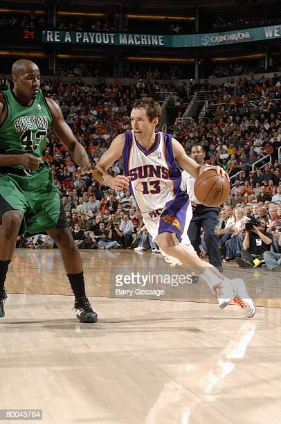 Steve Nash of the Phoenix Suns drives to the basket against Kendrick Perkins of the Boston Celtics during the game at U.S. Airways Center on February...