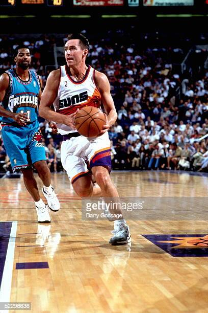Steve Nash of the Phoenix Suns drives to the basket against the Vancouver Grizzlies circa 1997 during an NBA game at the America West Arena in...