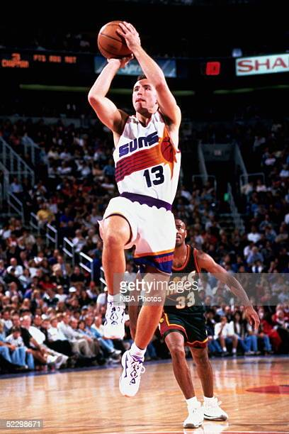 Steve Nash of the Phoenix Suns drives to the basket for a jumpshot against the Seattle Sonics during an NBA game circa 1997 at the America West Arena...