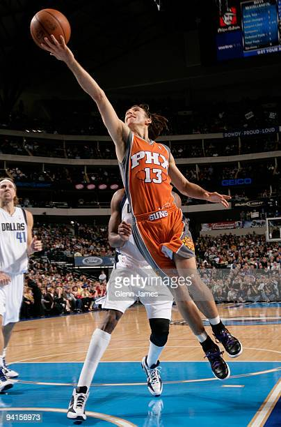 Steve Nash of the Phoenix Suns goes in for the layup against the Dallas Mavericks during a game at the American Airlines Center on December 8 2009 in...