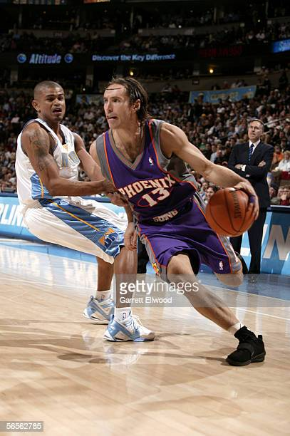Steve Nash of the Phoenix Suns goes to the basket against Earl Watson of the Denver Nuggets on January 10 2006 at the Pepsi Center in Denver Colorado...