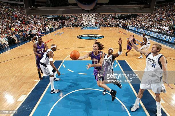 Steve Nash of the Phoenix Suns goes to the basket against Jason Terry and Dirk Nowitzki of the Dallas Mavericks in Game four of the Western...