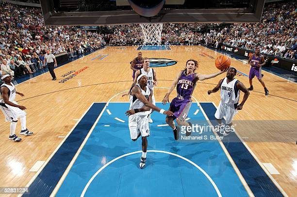 Steve Nash of the Phoenix Suns goes to the basket against Josh Howard of the Dallas Mavericks in Game four of the Western Conference Semifinals...