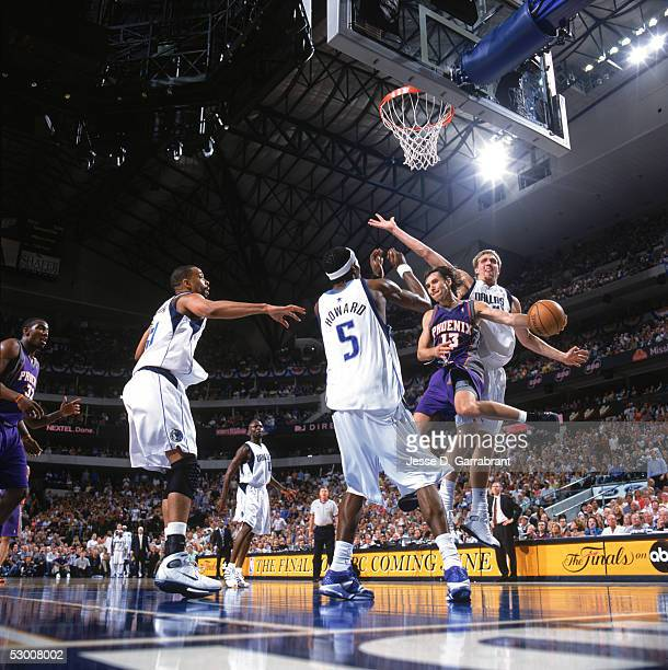 Steve Nash of the Phoenix Suns goes to the basket between Josh Howard and Dirk Nowitzki of the Dallas Mavericks in Game six of Western Conference...