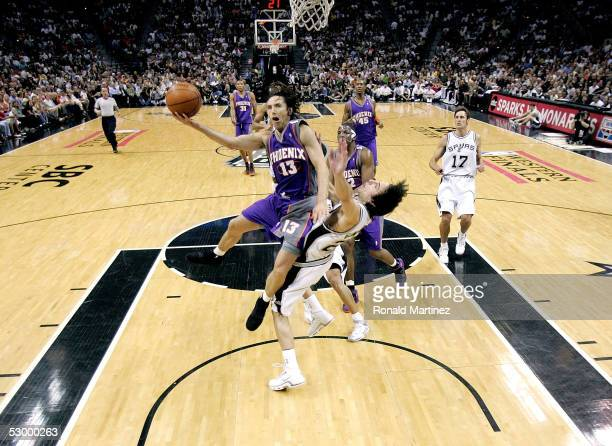 Steve Nash of the Phoenix Suns goes to the basket over Manu Ginobili of the San Antonio Spurs in Game four of the Western Conference Finals during...