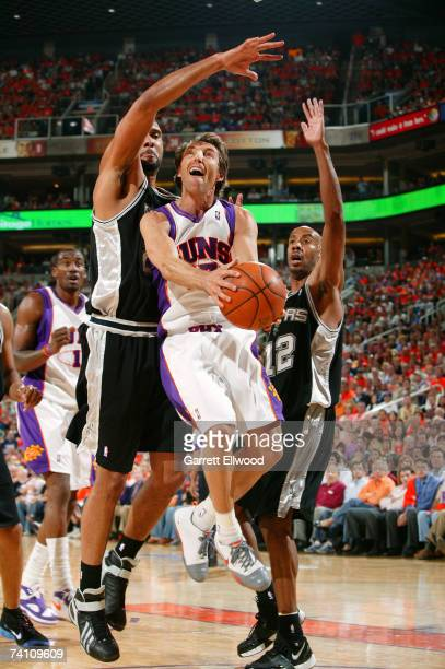 Steve Nash of the Phoenix Suns goes to the hoop against Tim Duncan and Bruce Bowen of the San Antonio Spurs in Game Two of the Western Conference...