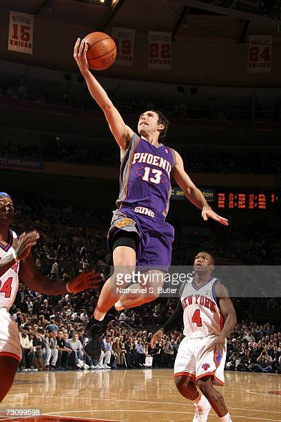 Steve Nash of the Phoenix Suns goes up for a layup against Eddie Curry and Nate Robinson of the New York Knicks in NBA action January 24 2007 at...