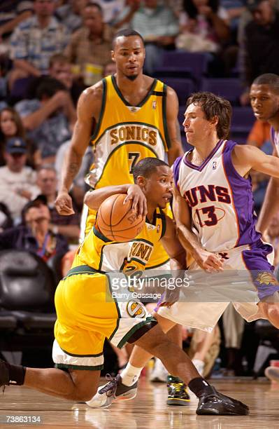 Steve Nash of the Phoenix Suns guards Mike Wilks of the Seattle SuperSonics as he slips in an NBA game played on April 11 at US Airways Center in...