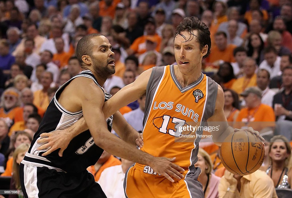 Steve Nash #13 of the Phoenix Suns handles the ball under pressure from Tony Parker #9 of the San Antonio Spurs during Game Two of the Western Conference Semifinals of the 2010 NBA Playoffs at US Airways Center on May 5, 2010 in Phoenix, Arizona. The team is wearing 'Los Suns' jerseys on Cinco de Mayo in response to an anti-immigration law recently passed in Arizona. The Suns defeated the Spurs 110-102 to take a 2-0 series lead.