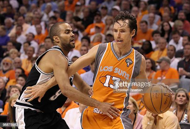 Steve Nash of the Phoenix Suns handles the ball under pressure from Tony Parker of the San Antonio Spurs during Game Two of the Western Conference...