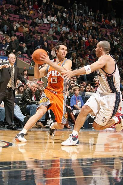 d448692b068 Steve Nash  13 of the Phoenix Suns holds the ball away from Jason Kidd