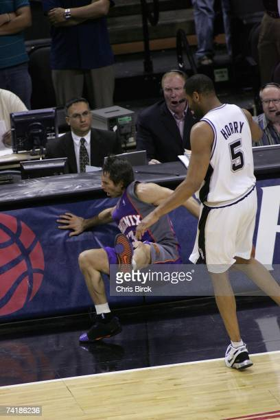 Steve Nash of the Phoenix Suns is fouled into the scorer's table by Robert Horry of the San Antonio Spurs in Game Four of the Western Conference...