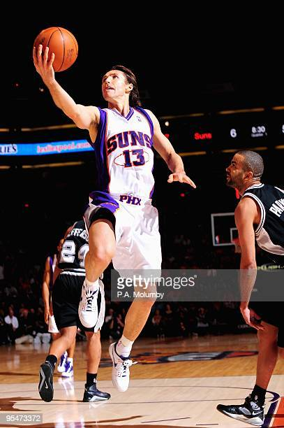 Steve Nash of the Phoenix Suns lays the ball up over Tony Parker of the San Antonio Spurs during the game on December 15 2009 at US Airways Center in...