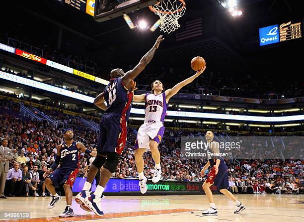 Steve Nash of the Phoenix Suns lays up a shot against Shaquille O'Neal of the Cleveland Cavaliers during the NBA game at US Airways Center on...