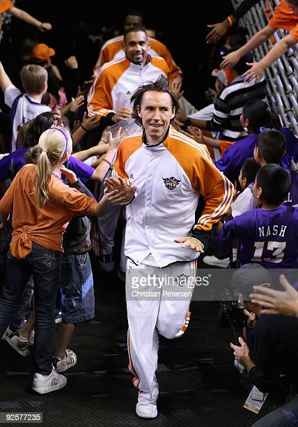Steve Nash of the Phoenix Suns leads teammates out onto the court before the NBA game against the Golden State Warriors at US Airways Center on...