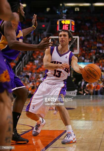Steve Nash of the Phoenix Suns looks to pass around Ronny Turiaf of the Los Angeles Lakers in Game One of the Western Conference Quarterfinals during...