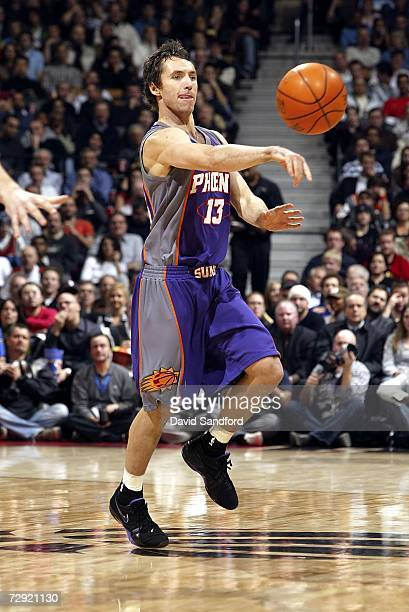 Steve Nash of the Phoenix Suns makes a pass while facing the Toronto Raptors on January 3 2007 at the Air Canada Centre in Toronto Canada The Suns...