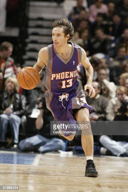 Steve Nash of the Phoenix Suns moves the ball during the game with the Minnesota Timberwolves on January 4 2005 at the Target Center in Minneapolis...