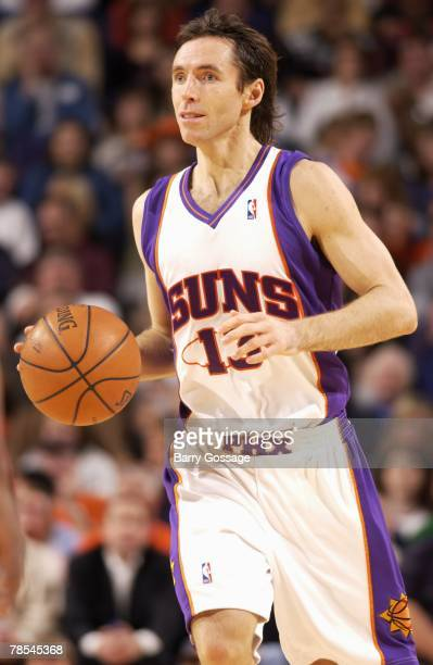 Steve Nash of the Phoenix Suns moves the ball up court during the game against the Houston Rockets at US Airways Center on November 28 2007 in...