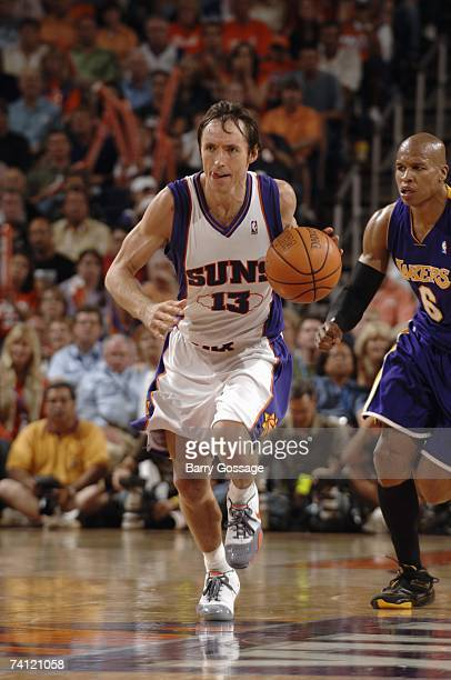 Steve Nash of the Phoenix Suns moves the ball up court past Maurice Evans of the Los Angeles Lakers in Game Five of the Western Conference...
