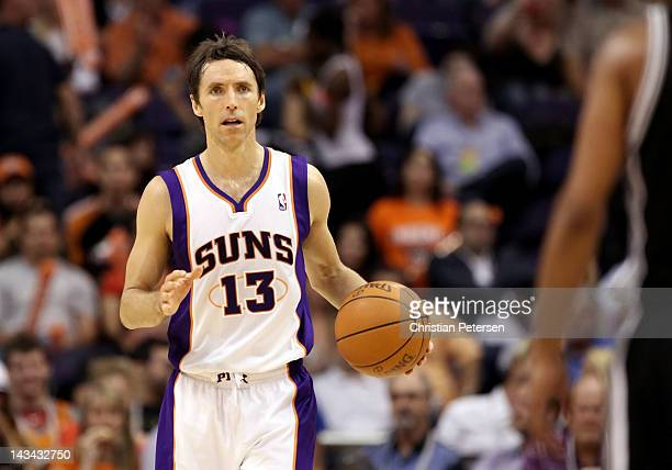 Steve Nash of the Phoenix Suns moves the ball upcourt during the NBA game against the San Antonio Spurs at US Airways Center on April 25 2012 in...