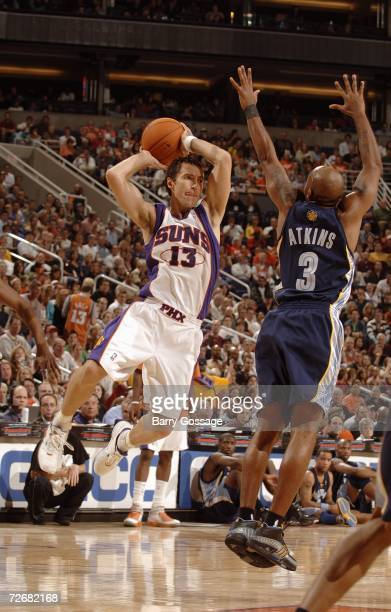 Steve Nash of the Phoenix Suns passes against Chucky Atkins the Memphis Grizzlies at US Airways Center on November 11 2006 in Phoenix Arizona The...