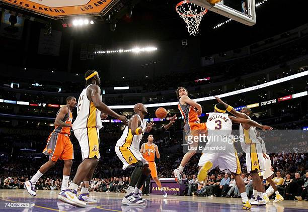 Steve Nash of the Phoenix Suns passes the ball behind his back under pressure from the Los Angeles Lakers in Game Four of the Western Conference...
