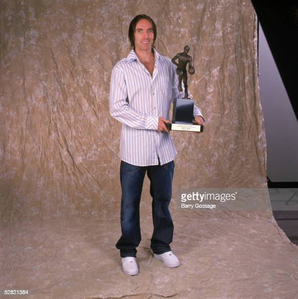 Steve Nash of the Phoenix Suns poses with the Maurice Podoloff Trophy for the NBA's Most Valuable Player for the 20042005 season at America West...
