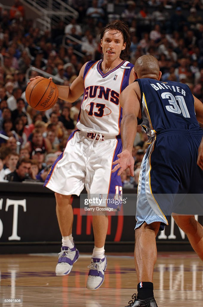Steve Nash #13 of the Phoenix Suns prepares to drive against Shane Battier #31 of the Memphis Grizzlies in Game one of the Western Conference Quarterfinals during the 2005 NBA Playoffs on April 24, 2005 at America West Arena in Phoenix, Arizona.