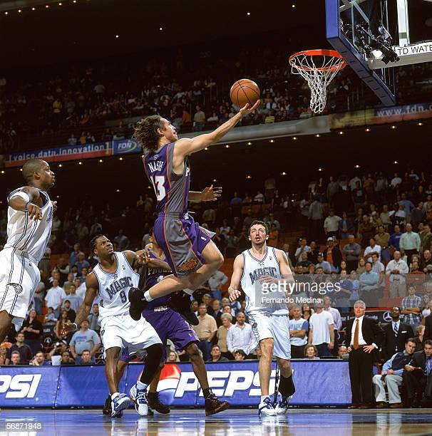 Steve Nash of the Phoenix Suns reaches for the basket against DeShawn Stevenson and Hedo Turkoglu of the Orlando Magic at TD Waterhouse Centre on...