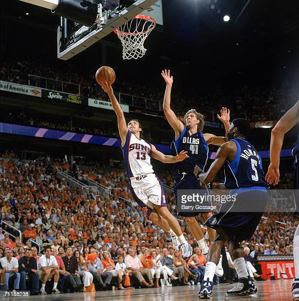 Steve Nash of the Phoenix Suns reaches for the basket against Dirk Nowitzki of the Dallas Mavericks in game three of the Western Conference Finals...