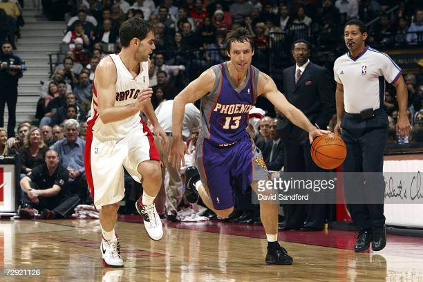 Steve Nash of the Phoenix Suns runs the ball up court as he is defended by Jose Calderon of the Toronto Raptors on January 3 2007 at the Air Canada...