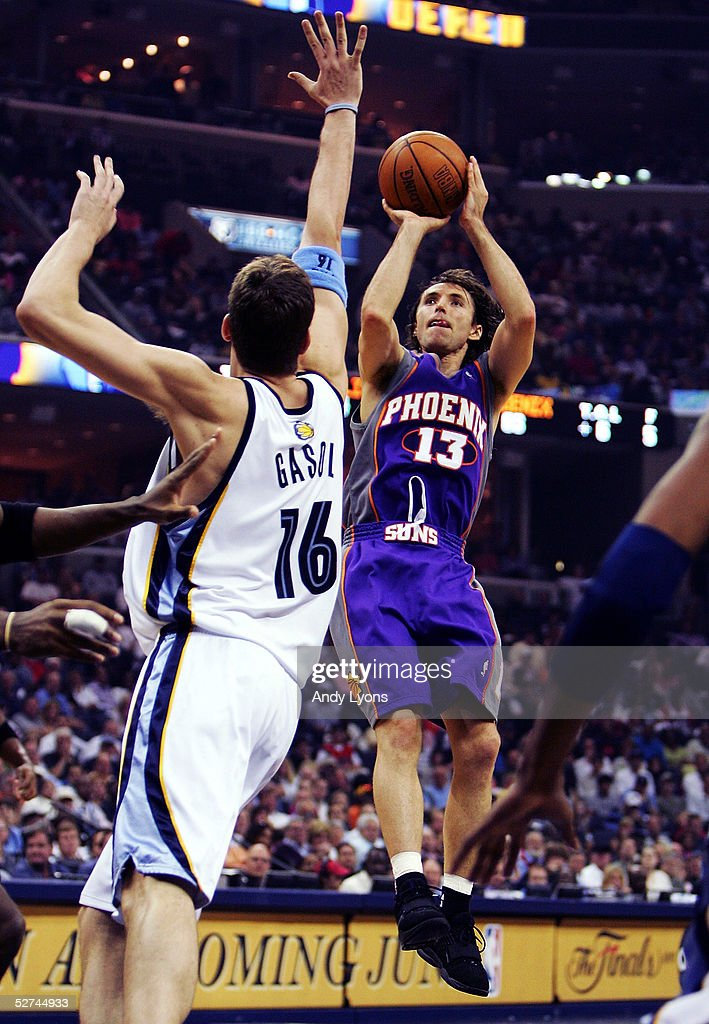 Steve Nash #13 of the Phoenix Suns shoots over Pau Gasol #16 of the Memphis Grizzlies in Game four of the Western Conference Quarterfinals during the 2005 NBA Playoffs at the FedExForum on May 1, 2005 in Memphis, Tennessee.