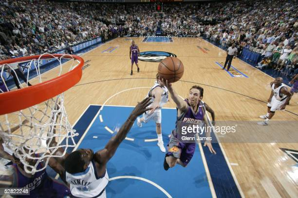Steve Nash of the Phoenix Suns soars to the basket against the Dallas Mavericks in Game three of the Western Conference Semifinals during the 2005...