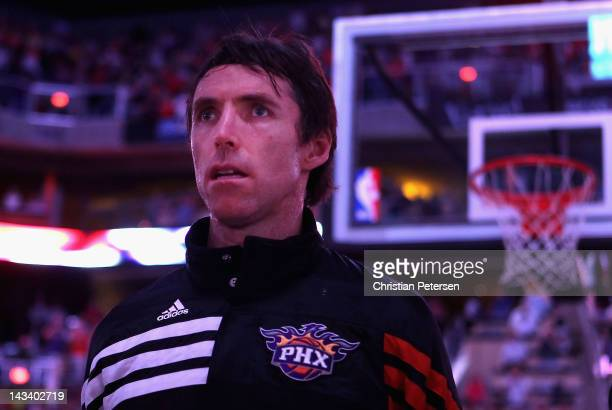 Steve Nash of the Phoenix Suns stands attended for the National Anthem before the NBA game against the San Antonio Spurs at US Airways Center on...