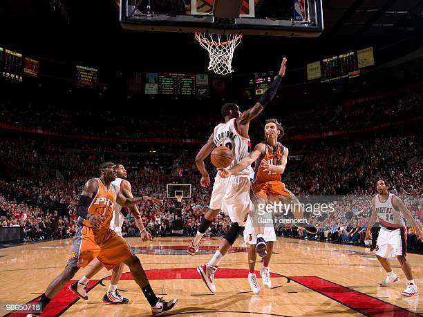 Steve Nash of the Phoenix Suns throws a pass around LaMarcus Aldridge of the Portland Trail Blazers in Game Four of the Western Conference...