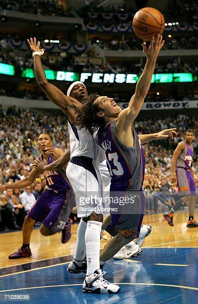 Steve Nash of the Phoenix Suns tosses up a basket as he is fouled by Jason Terry of the Dallas Mavericks in game one of the Western Conference Finals...