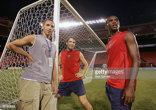 Steve Nash of the Phoenix Suns with FC Barcelona's Thiago Motta and Samuel Eto'o after Barcelona's practice at Giants Stadium in East Rutherford,...