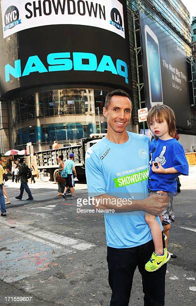 Steve Nash Showdown Founder and President of the Steve Nash Foundation with son Matteo Joel Nash visit at NASDAQ MarketSite on June 26 2013 in New...