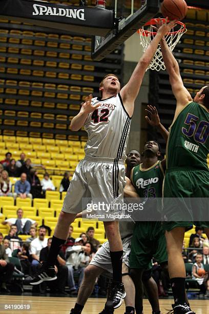 Steve Newman of the Utah Flash shoots a layup against Jesse Smith of the Reno Bighorns during the game at McKay Events Center on December 15 2008 in...