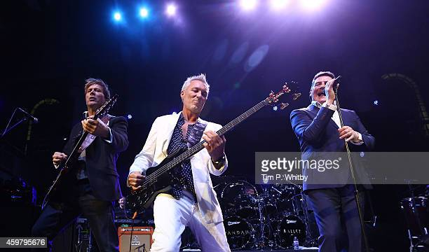 Steve Norman Martin Kemp and Tony Hadley of Spandau Ballet perform as Magic present Spandau Ballet at LSO St Lukes on December 1 2014 in London...
