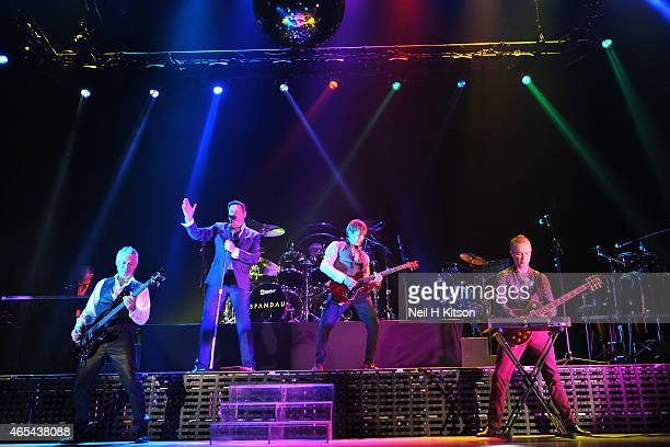 Steve Norman Tony Hadley John Keeble Martin Kemp and Gary Kemp of Spandau Ballet performs on stage at Sheffield Arena on March 6 2015 in Sheffield...