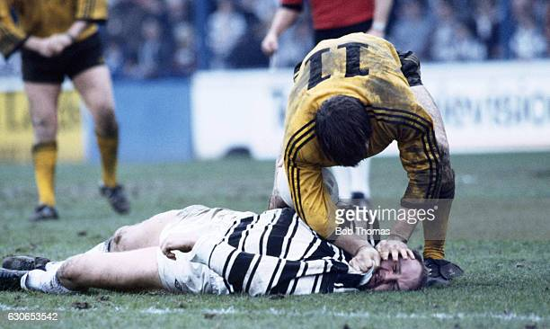 Steve Norton of Hull is held down by Keith England of Castleford during the State Express Rugby League Challenge Cup SemiFinal between Castleford and...